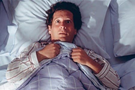 Мужчина в кровати