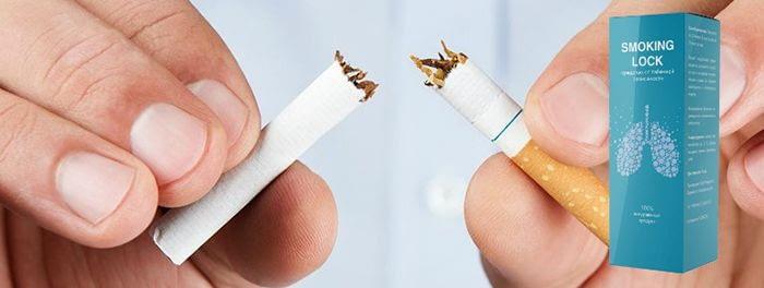 руки мужчины разламывают сигарету